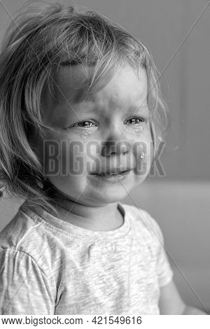 Sad Unhappy Crying Cute Little Baby Girl, Black And White Photo