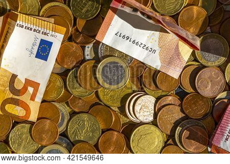 Euro Banknotes And Coins Of European Currency As Background. Handful Of Coins. Scattering Of Coins.