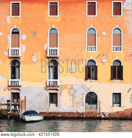 Typical Canal Street In Venice. Grand Canal In Venice.colorful Facades Of Old Medieval Houses. The F