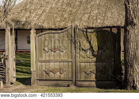 Antique Vintage Wooden Rustic House Gate In The Ukrainian Village. The Barn Door Is Made Of Wood And