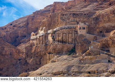 The Monastery Of The Temptation On The Red Rocks. The Mount Of Temptation In Jericho, Palestine. Gre