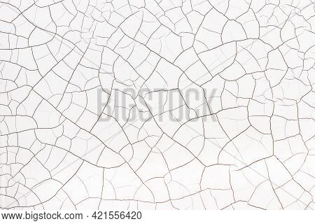 Cracked Abstract White Background. Fractured White Backdrop. Texture Of A Broken Surface.