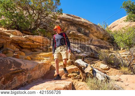 Hike in the Utah mountains. Hiking in unusual natural landscapes. Fantastic forms sandstone formations.