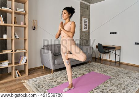 Young Healthy African American Mixed Race Girl Standing On Mat At Home In Namaste Pose Meditating Br