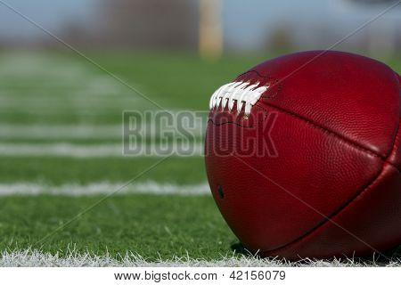 American Football on the Field with the hashmark yardlines carrying off