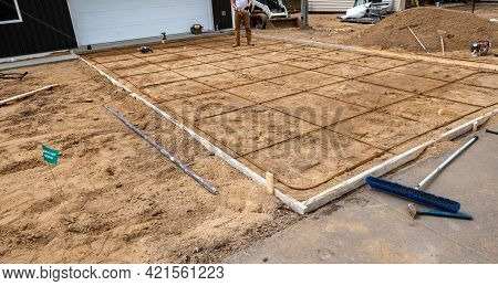 Wood Frame And Reinforcing Steel Rods Or Rebar Used In Preparation For Concrete Driveway At A Constr