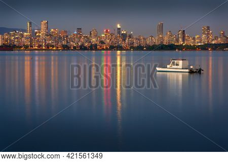 English Bay Twilight Cityscape Vancouver. The View Of The Vancouver Skyline From Jericho Beach On En