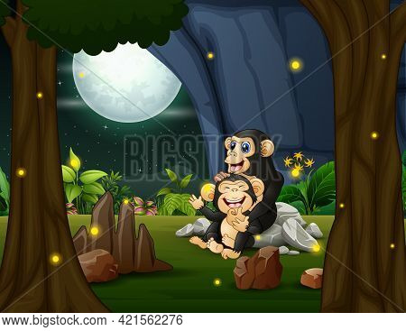 Happy Chimpanzee With Her Cub In The Jungle At Night