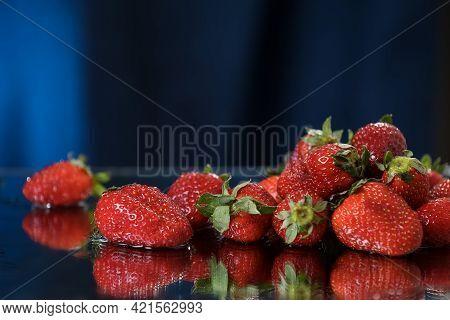 Strawberries Closeup On A Dark Blue Background. Healthy Lifestyle. Multivitamin Cocktail. Summer Die