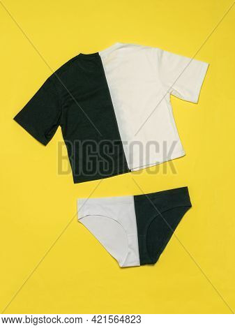 Set Of Black And White T-shirt And Black And White Shorts On A Yellow Background. Contrasting Set Of