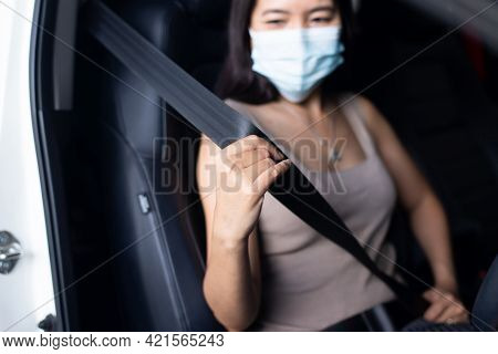 Woman Driver Fastens Seat Belt Before Driving A Car,safety Concept For Vehicles