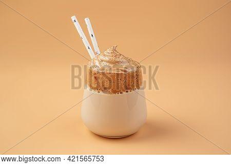 Coffee Dessert With Whipped Foam On An Orange Background. Dalgona Invigorating Coffee. Copy Space.