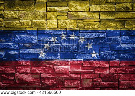 National Flag Of Venezuela On Stone  Wall Background.the Concept Of National Pride And Symbol Of The