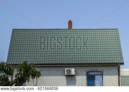 Roof Structure Covered With Green Metal Tiles On A Bright Sunny Day. Modern Housing Construction. Ty