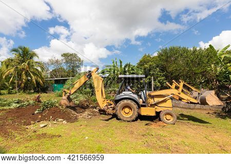 Panama David May 20, Earthmoving Machine At Work To Level The Ground And Remove Shrubs In A Sunny Da
