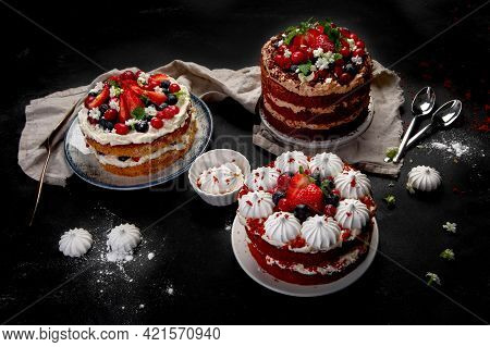 Assorted Delicious And Colorful Homemade Cakes With Different Type Of Filling On Black Background.