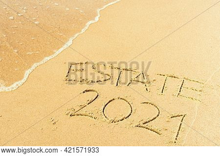 Estate 2021 Written On The Sand Of A Beach With Wave Washing, Erasing Or Canceling It During Coronav