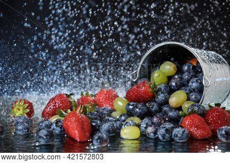 Fruit Salad Close Up In Metal Bucket. Strawberry, Grape, Blueberry Multivitamin Cocktail. Healthy Li