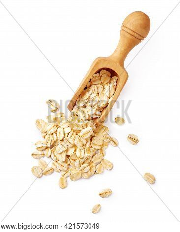 Oat Flakes In Wooden Spoon Isolated On White Background. Top View Of Oat Flakes For Oatmeal And Gran