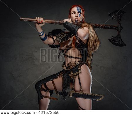 Sexy And Muscular Woman Viking Holding An Axe On Her Shoulder