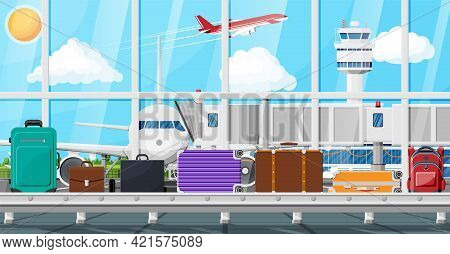 Luggage Carousel Against Airport Window With Taking Off Plane. Conveyor Belt With Passenger Luggage.