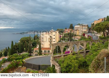 Cityscape of Taormina with historical buildings at cloudy day, Sicily, Italy