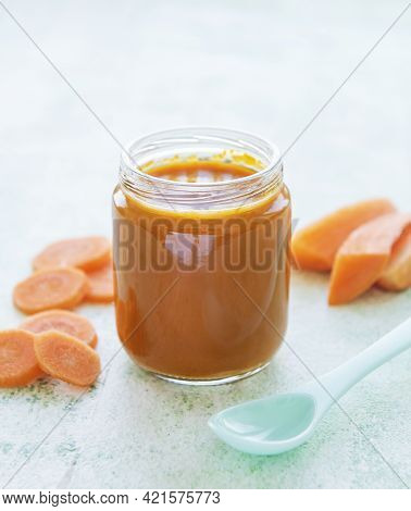 Baby Carrot Mashed With Spoon In Glass Jar, Baby Food