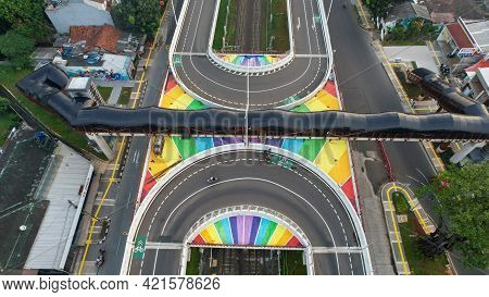 Aerial View Of Infinity Sign Traffic Junction Cross Road With Car Transport. Jakarta, May 25, 2021
