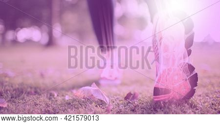 Composition of woman's legs running with visible x ray bones and pink tint. technology, sport, fitness and active lifestyle concept digitally generated image.