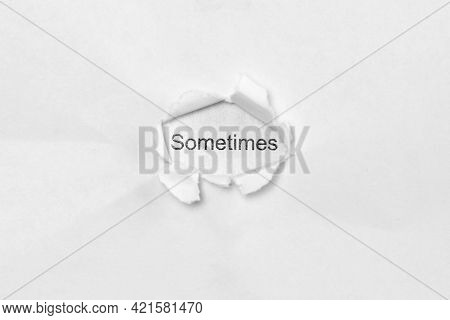 Word Sometimes On White Isolated Background, The Inscription Through The Wound Hole In Paper. Concep