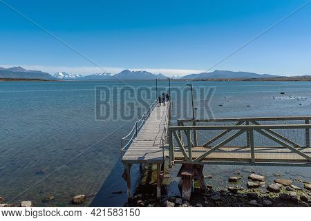 Puerto Natales, Chile February 08, 2020: Wooden Jetty Near The Port City Of Puerto Natales, Chile