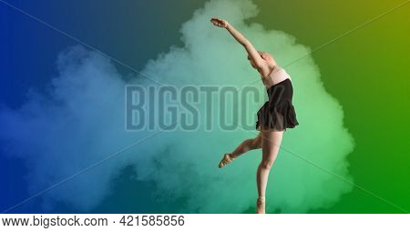 Composition of athletic woman dancing over smoke on colorful background. sport, fitness and active lifestyle concept digitally generated image.