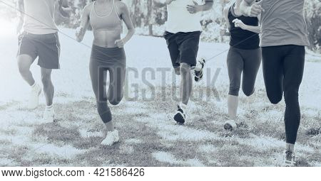 Composition of group of fit people running over light blur. sport, fitness and active lifestyle concept digitally generated image.