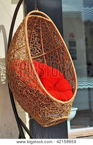 Sleeping Chair with red hassock in Nature