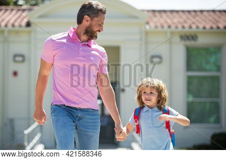 Father And Son Run With Father After Come Back From School. School, Family, Education And Outdoor Co