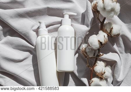 Beauty Spa Branding Mock-up. Natural Organic Eco Cosmetics. White Cosmetic Bottles, Cotton Flowers O