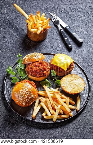 Bbq Sloppy Joe Sandwiches With French Fries On A Black Plate, Vertical View, American Cuisine