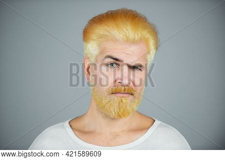 Barbershop. Dyed Man Hair. Blonde Guy With Long Beard And Moustache.
