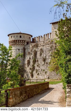 The Inner Walls Of A Medieval Castle With An Observation Tower In The City Of Brescia, Lombardy, Ita