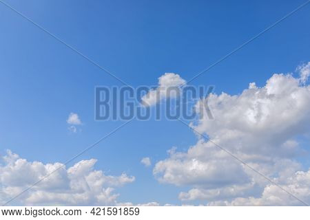 Blue Sky In Perspective To The Horizon With Lush Clouds