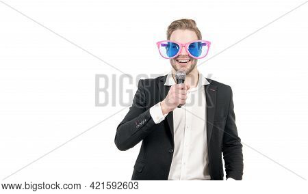 Funny Man In Business Formalwear And Party Glasses Hold Microphone Happy Smiling, Showman