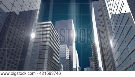 Composition of network of light trails over grid and cityscape. global connections, networking and business concept digitally generated image.