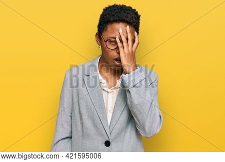 Young african american woman wearing business clothes yawning tired covering half face, eye and mouth with hand. face hurts in pain.