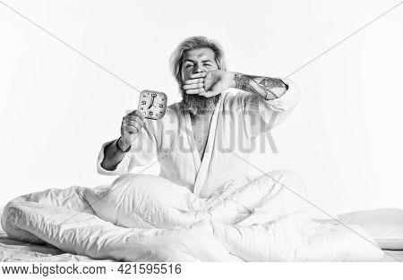 Break Discipline Regime. Mature Man On Bed Turning Off Clock. Mature Man Turn Off Alarm Clock. Digit