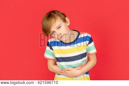 Child Has Stomachache With Food Poisoning. Child Holding Hands On Belly. Stomach Pain. Teen Boy With