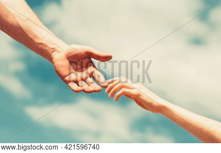 Giving A Helping Hand. Hands Of Man And Woman Reaching To Each Other, Support. Hands Of Man And Woma