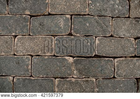 Popular Urban Street Gray Paving Slabs. Paving Texture Of The Stones And Boulders