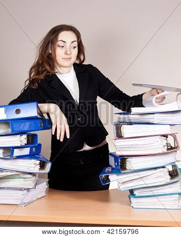 Woman With Tons Of Folders
