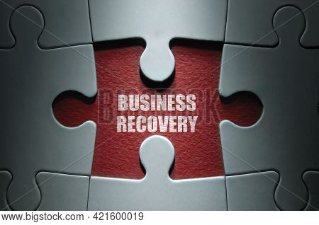 Missing Piece From A Clock Jigsaw Puzzle With Business Recovery In The Center