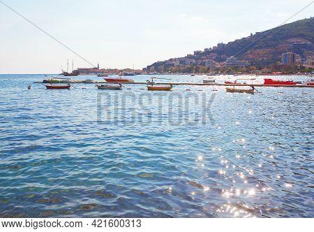 Boats In Budva Riviera . Tourist Resorts And Hotels On The Adriatic Sea Coast In Montenegro